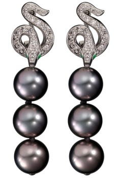 Boucheron snake earring in 14kt white gold accented with pave diamonds and dropped black pearls.