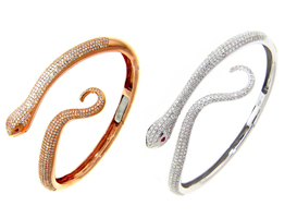Michael John Jewelry's snake bangles, made in (from left) 18-karat rose gold with round brilliant diamonds and rubies ($16,150) and 18-karat white gold bangle with round brilliant diamonds and rubies ($16,150).
